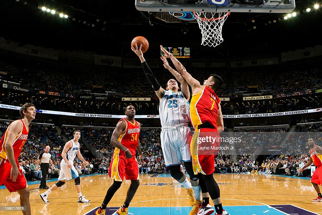 <a gi-track='captionPersonalityLinkClicked' href=/galleries/search?phrase=Austin+Rivers&family=editorial&specificpeople=7117574 ng-click='$event.stopPropagation()'>Austin Rivers</a> #25 of the New Orleans Hornets drives to the basket against <a gi-track='captionPersonalityLinkClicked' href=/galleries/search?phrase=Jeremy+Lin&family=editorial&specificpeople=6669516 ng-click='$event.stopPropagation()'>Jeremy Lin</a> #7 of the Houston Rockets on January 9, 2013 at the New Orleans Arena in New Orleans, Louisiana.