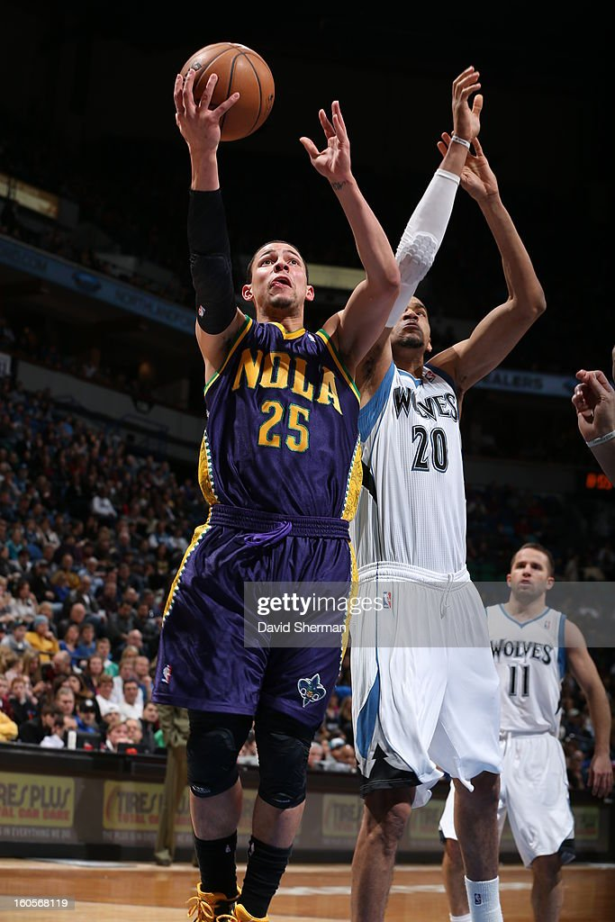 <a gi-track='captionPersonalityLinkClicked' href=/galleries/search?phrase=Austin+Rivers&family=editorial&specificpeople=7117574 ng-click='$event.stopPropagation()'>Austin Rivers</a> #25 of the New Orleans Hornets drives to the basket against Chris Johnson #20 of the Minnesota Timberwolves on February 2, 2013 at Target Center in Minneapolis, Minnesota.