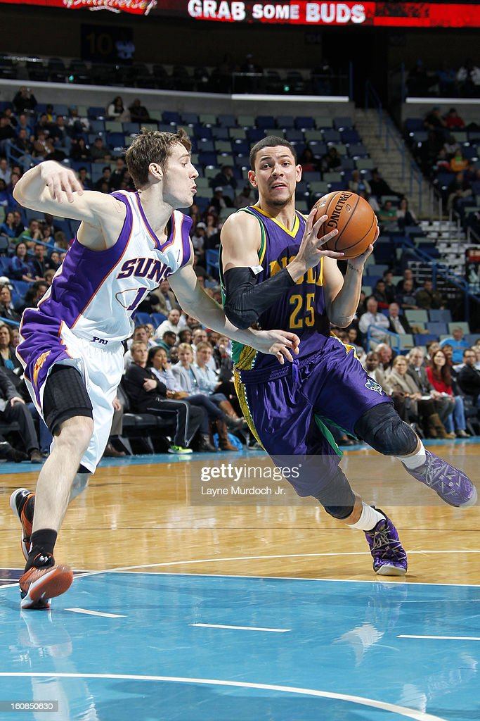 <a gi-track='captionPersonalityLinkClicked' href=/galleries/search?phrase=Austin+Rivers&family=editorial&specificpeople=7117574 ng-click='$event.stopPropagation()'>Austin Rivers</a> #25 of the New Orleans Hornets drives to the basket against <a gi-track='captionPersonalityLinkClicked' href=/galleries/search?phrase=Goran+Dragic&family=editorial&specificpeople=4452965 ng-click='$event.stopPropagation()'>Goran Dragic</a> #1 of the Phoenix Suns on February 06, 2013 at the New Orleans Arena in New Orleans, Louisiana.