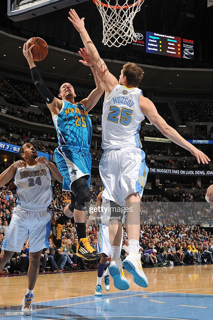 Austin Rivers #25 of the New Orleans Hornets drives to the basket against Timofey Mozgov #25 of the Denver Nuggets on February 1, 2013 at the Pepsi Center in Denver, Colorado.