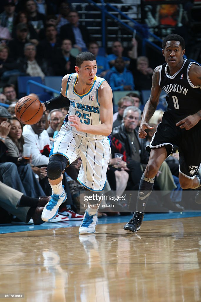 Austin Rivers #25 of the New Orleans Hornets drives up-court against MarShon Brooks #9 of the Brooklyn Nets on February 26, 2013 at the New Orleans Arena in New Orleans, Louisiana.