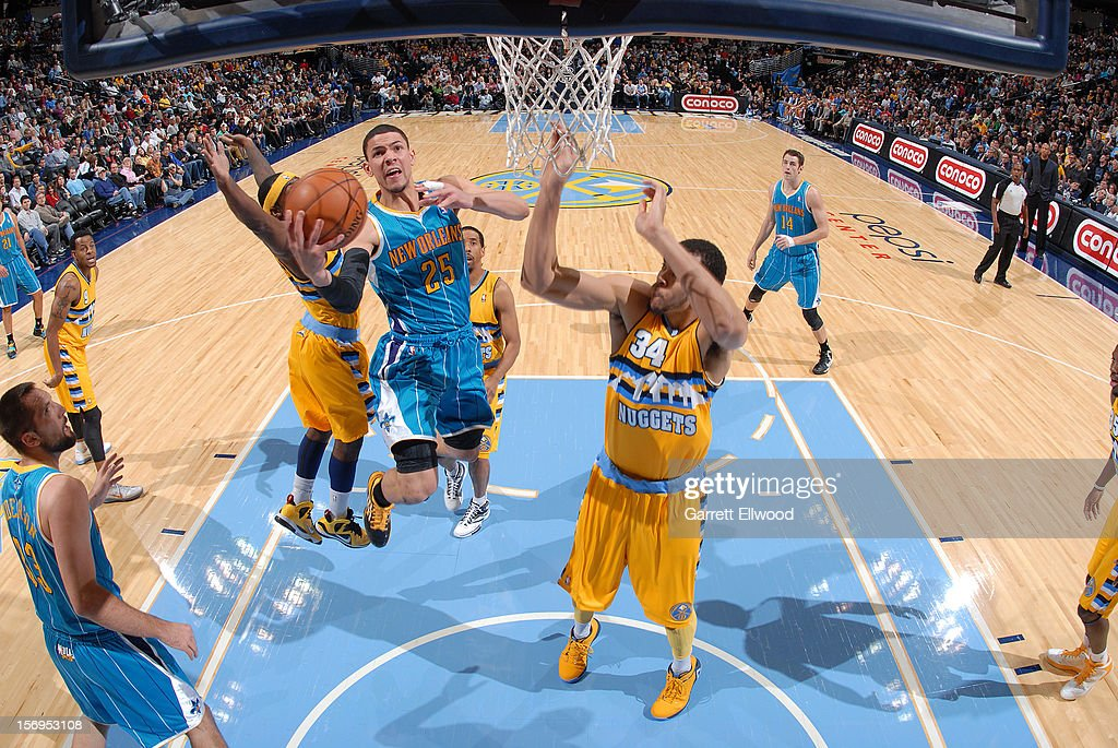 <a gi-track='captionPersonalityLinkClicked' href=/galleries/search?phrase=Austin+Rivers&family=editorial&specificpeople=7117574 ng-click='$event.stopPropagation()'>Austin Rivers</a> #25 of the New Orleans Hornets goes to the basket during the game between the New Orleans Hornets and the Denver Nuggets on November 25, 2012 at the Pepsi Center in Denver, Colorado.