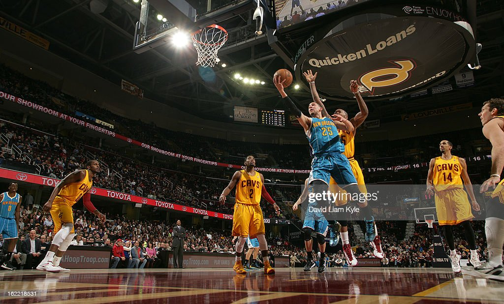 Austin Rivers #25 of the New Orleans Hornets goes up for the shot against Marreese Speights #15 of the Cleveland Cavaliers at The Quicken Loans Arena on February 20, 2013 in Cleveland, Ohio.