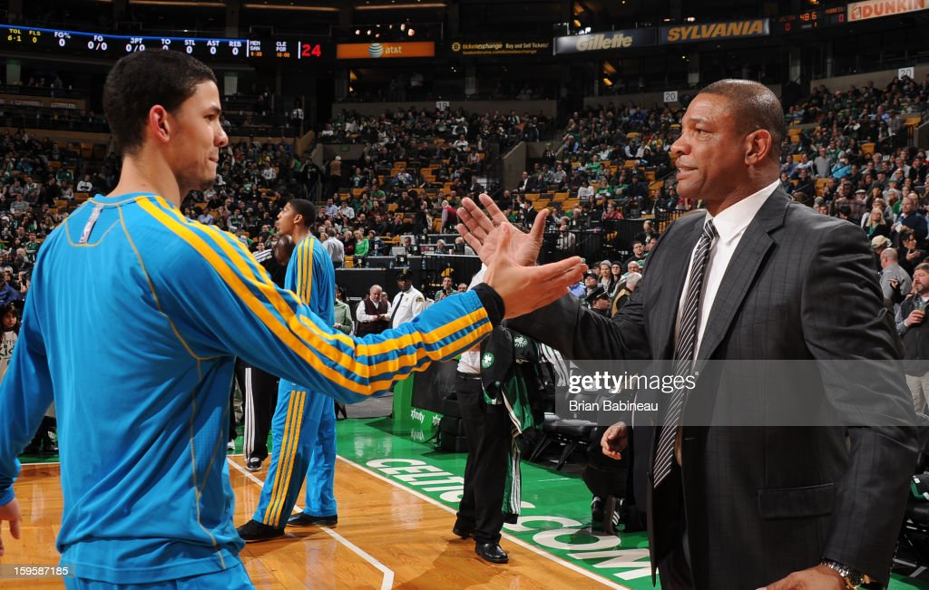 Austin Rivers of the New Orleans Hornets greets his dad Doc Rivers head coach of the Boston Celtics on January 16 2013 at the TD Garden in Boston...