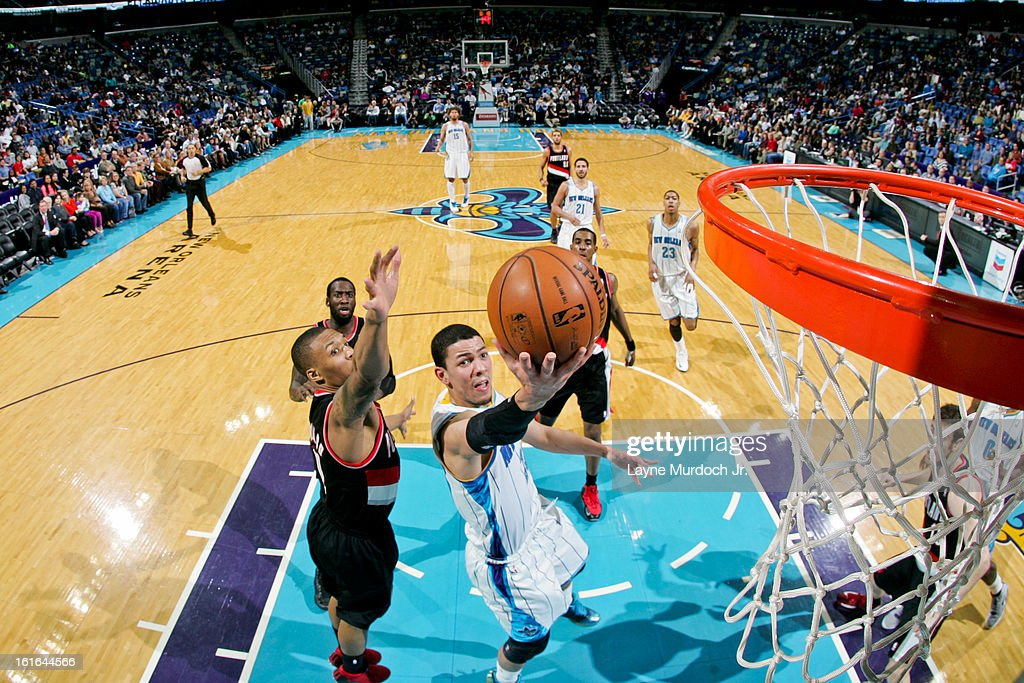 <a gi-track='captionPersonalityLinkClicked' href=/galleries/search?phrase=Austin+Rivers&family=editorial&specificpeople=7117574 ng-click='$event.stopPropagation()'>Austin Rivers</a> #25 of the New Orleans Hornets shoots a layup against <a gi-track='captionPersonalityLinkClicked' href=/galleries/search?phrase=Damian+Lillard&family=editorial&specificpeople=6598327 ng-click='$event.stopPropagation()'>Damian Lillard</a> #0 of the Portland Trail Blazers on February 13, 2013 at the New Orleans Arena in New Orleans, Louisiana.