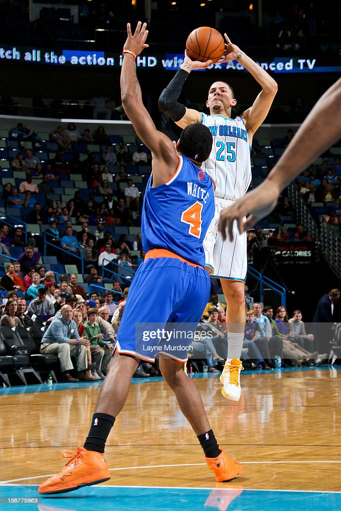 Austin Rivers #25 of the New Orleans Hornets shoots a three-pointer against James White #4 of the New York Knicks on November 20, 2012 at the New Orleans Arena in New Orleans, Louisiana.
