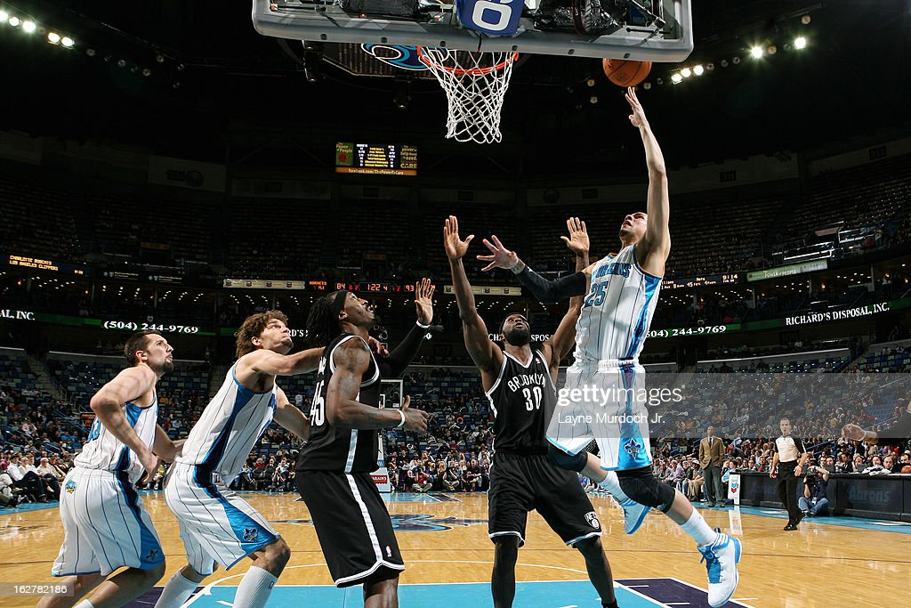 <a gi-track='captionPersonalityLinkClicked' href=/galleries/search?phrase=Austin+Rivers&family=editorial&specificpeople=7117574 ng-click='$event.stopPropagation()'>Austin Rivers</a> #25 of the New Orleans Hornets shoots against <a gi-track='captionPersonalityLinkClicked' href=/galleries/search?phrase=Reggie+Evans&family=editorial&specificpeople=202254 ng-click='$event.stopPropagation()'>Reggie Evans</a> #30 of the Brooklyn Nets on February 26, 2013 at the New Orleans Arena in New Orleans, Louisiana.