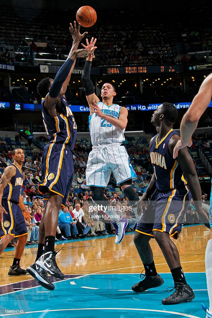 Austin Rivers #25 of the New Orleans Hornets shoots in the lane against Ian Mahinmi #28 of the Indiana Pacers on December 22, 2012 at the New Orleans Arena in New Orleans, Louisiana.