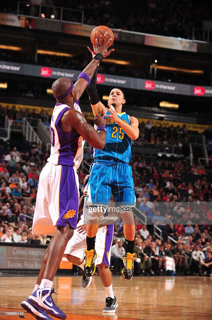 <a gi-track='captionPersonalityLinkClicked' href=/galleries/search?phrase=Austin+Rivers&family=editorial&specificpeople=7117574 ng-click='$event.stopPropagation()'>Austin Rivers</a> #25 of the New Orleans Hornets shoots over the block of <a gi-track='captionPersonalityLinkClicked' href=/galleries/search?phrase=Jermaine+O%27Neal&family=editorial&specificpeople=201524 ng-click='$event.stopPropagation()'>Jermaine O'Neal</a> #20 of the Phoenix Suns on November 23, 2012 at U.S. Airways Center in Phoenix, Arizona.