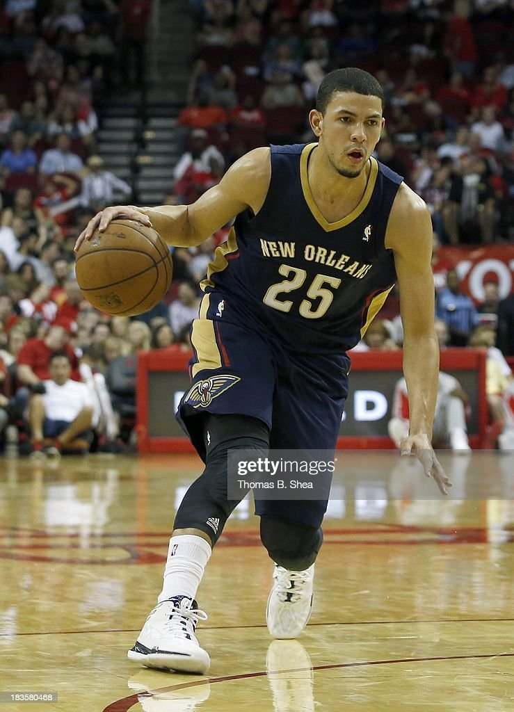 Austin Rivers #25 of the New Orleans Pelicans dribbles against the Houston Rockets in a preseason NBA game on October 5, 2013 at Toyota Center in Houston, Texas. The Pelicans won 116 to 115.