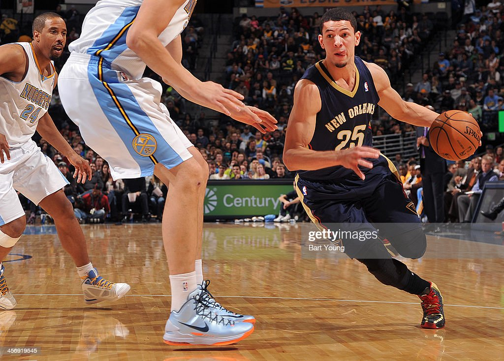 <a gi-track='captionPersonalityLinkClicked' href=/galleries/search?phrase=Austin+Rivers&family=editorial&specificpeople=7117574 ng-click='$event.stopPropagation()'>Austin Rivers</a> #25 of the New Orleans Pelicans dribbles to the basket against the Denver Nuggets on December 15, 2013 at the Pepsi Center in Denver, Colorado.