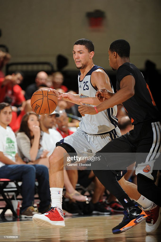 Austin Rivers #25 of the New Orleans Pelicans dribbles up the court against the New York Knicks during NBA Summer League on July 12, 2013 at the Cox Pavilion in Las Vegas, Nevada.