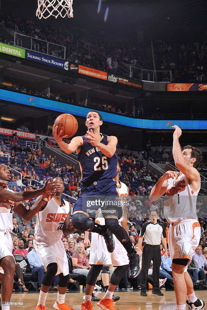 <a gi-track='captionPersonalityLinkClicked' href=/galleries/search?phrase=Austin+Rivers&family=editorial&specificpeople=7117574 ng-click='$event.stopPropagation()'>Austin Rivers</a> #25 of the New Orleans Pelicans drives for a shot past <a gi-track='captionPersonalityLinkClicked' href=/galleries/search?phrase=Goran+Dragic&family=editorial&specificpeople=4452965 ng-click='$event.stopPropagation()'>Goran Dragic</a> #1 of the Phoenix Suns on November 10, 2013 at U.S. Airways Center in Phoenix, Arizona.