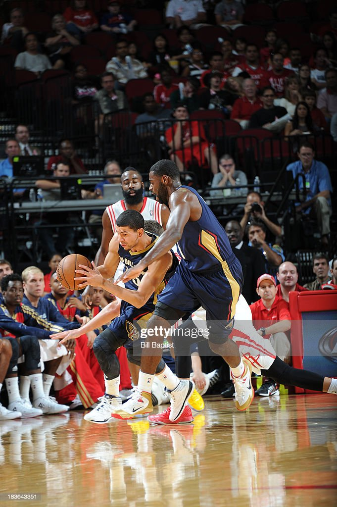 <a gi-track='captionPersonalityLinkClicked' href=/galleries/search?phrase=Austin+Rivers&family=editorial&specificpeople=7117574 ng-click='$event.stopPropagation()'>Austin Rivers</a> #25 of the New Orleans Pelicans drives the ball against the Houston Rockets during the 2013 NBA pre-season game on October 5, 2013 at the Toyota Center in Houston, Texas.