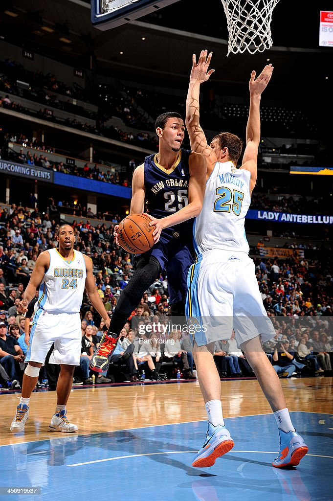 <a gi-track='captionPersonalityLinkClicked' href=/galleries/search?phrase=Austin+Rivers&family=editorial&specificpeople=7117574 ng-click='$event.stopPropagation()'>Austin Rivers</a> #25 of the New Orleans Pelicans drives to the basket against the Denver Nuggets on December 15, 2013 at the Pepsi Center in Denver, Colorado.