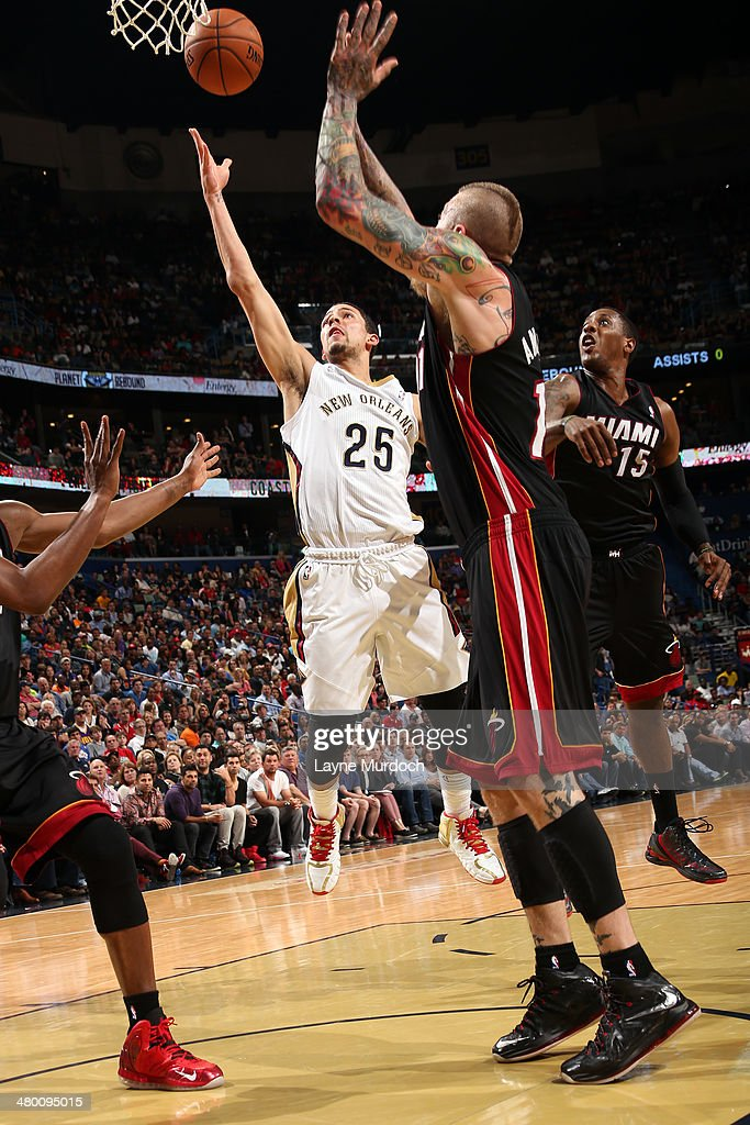 Austin Rivers #25 of the New Orleans Pelicans goes up for a shot against the Miami Heat on March 22, 2014 at the Smoothie King Center in New Orleans, Louisiana.