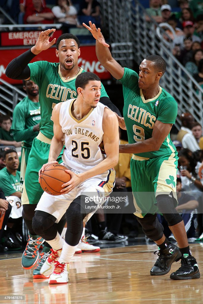 <a gi-track='captionPersonalityLinkClicked' href=/galleries/search?phrase=Austin+Rivers&family=editorial&specificpeople=7117574 ng-click='$event.stopPropagation()'>Austin Rivers</a> #25 of the New Orleans Pelicans looks to pass the ball against the Boston Celtics during an NBA game on March 16, 2014 at the Smoothie King Center in New Orleans, Louisiana.