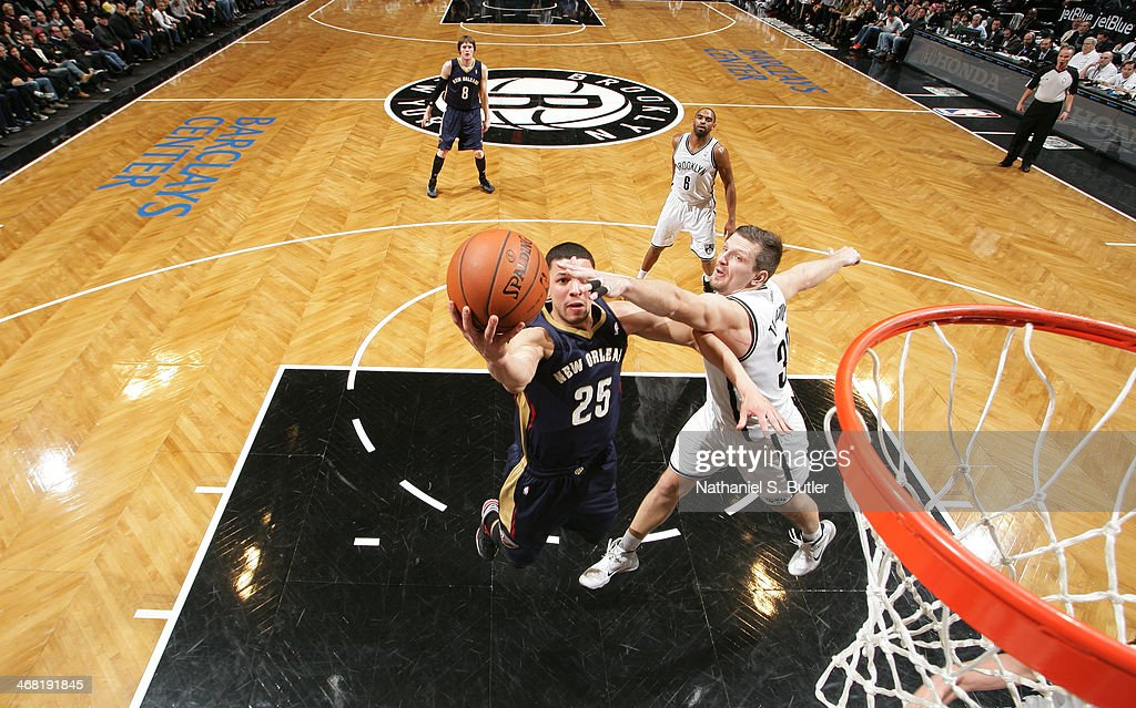 <a gi-track='captionPersonalityLinkClicked' href=/galleries/search?phrase=Austin+Rivers&family=editorial&specificpeople=7117574 ng-click='$event.stopPropagation()'>Austin Rivers</a> #25 of the New Orleans Pelicans shoots against <a gi-track='captionPersonalityLinkClicked' href=/galleries/search?phrase=Mirza+Teletovic&family=editorial&specificpeople=2255667 ng-click='$event.stopPropagation()'>Mirza Teletovic</a> #33 of the Brooklyn Nets during a game at the Barclays Center on February 9, 2014 in the Brooklyn borough of New York City.