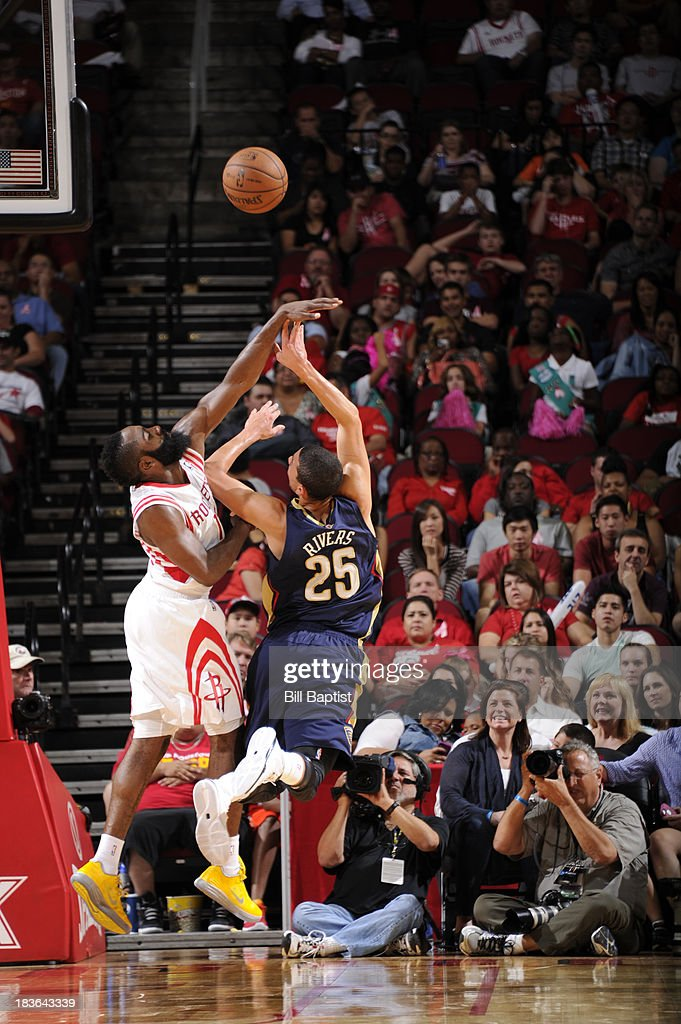 <a gi-track='captionPersonalityLinkClicked' href=/galleries/search?phrase=Austin+Rivers&family=editorial&specificpeople=7117574 ng-click='$event.stopPropagation()'>Austin Rivers</a> #25 of the New Orleans Pelicans shoots the ball against <a gi-track='captionPersonalityLinkClicked' href=/galleries/search?phrase=James+Harden&family=editorial&specificpeople=4215938 ng-click='$event.stopPropagation()'>James Harden</a> #13 of the Houston Rockets during the 2013 NBA pre-season game on October 5, 2013 at the Toyota Center in Houston, Texas.