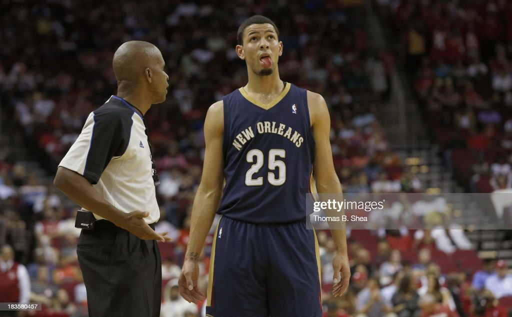 Austin Rivers #25 of the New Orleans Pelicans shows official Steve Anderson a cut on his tongue during a game against the Houston Rockets in a preseason NBA game on October 5, 2013 at Toyota Center in Houston, Texas. The Pelicans won 116 to 115.