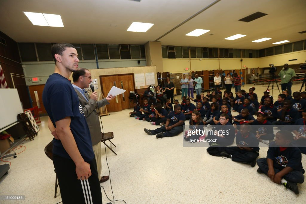 Austin Rivers of the New Orleans Pelicans speaks to elementary students and then gives each student tickets to the NBA All-Star Jam Session taking place in February on December 5, 2013 at Miller Wall Elementary in Marrero, Louisiana as a part of the Pelicans Season of Giving program.