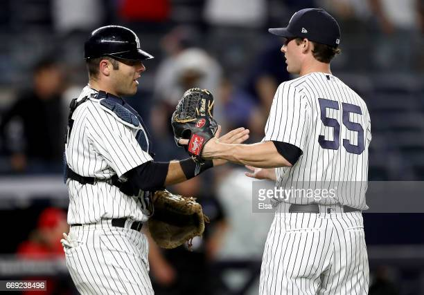 Austin Romine and Bryan Mitchell of the New York Yankees celebrate the 93 win over the St Louis Cardinals on April 16 2017 at Yankee Stadium in the...
