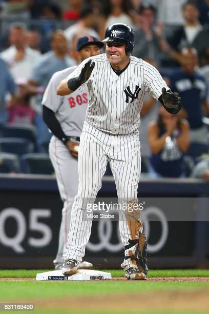 Austin Romine of the New York Yankees celebrates after hitting a RBI triple in the fifth inning against the Boston Red Sox at Yankee Stadium on...