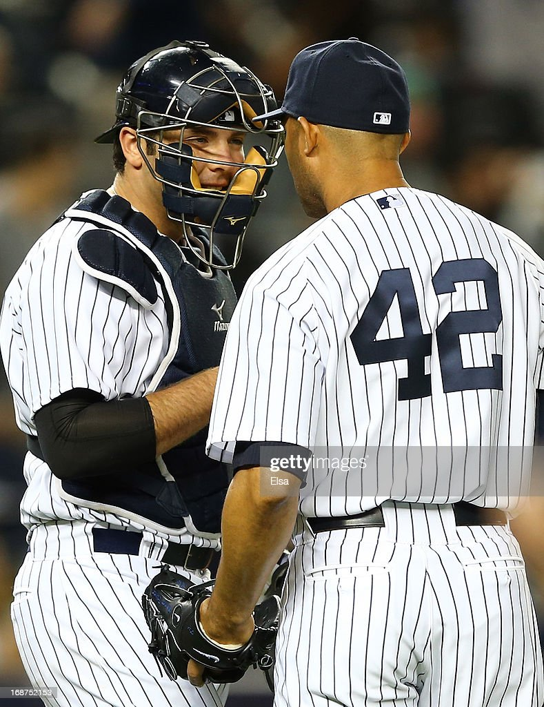 Austin Romine #53 of the New York Yankees celebrates the win with teammate Mariano Rivera #42 after the game against the Seattle Mariners on May 14, 2013 at Yankee Stadium in the Bronx borough of New York City.The New York Yankees defeated the Seattle Mariners 4-3.