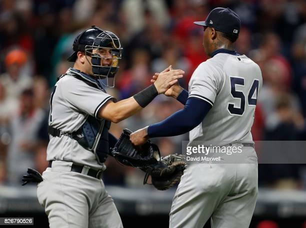 Austin Romine of the New York Yankees celebrates with Aroldis Chapman after defeating the Cleveland Indians at Progressive Field on August 5 2017 in...