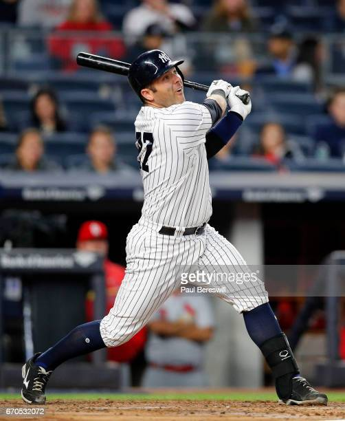 Austin Romine of the New York Yankees follows through on his solo home run during the second inning of an MLB baseball game against the St Louis...