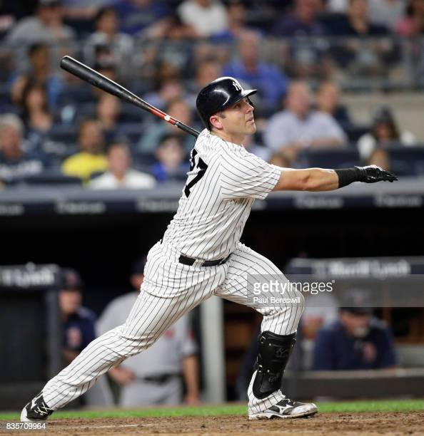 Austin Romine of the New York Yankees hits a triple in an MLB baseball game against the Boston Red Sox on August 13 2017 at Yankee Stadium in the...
