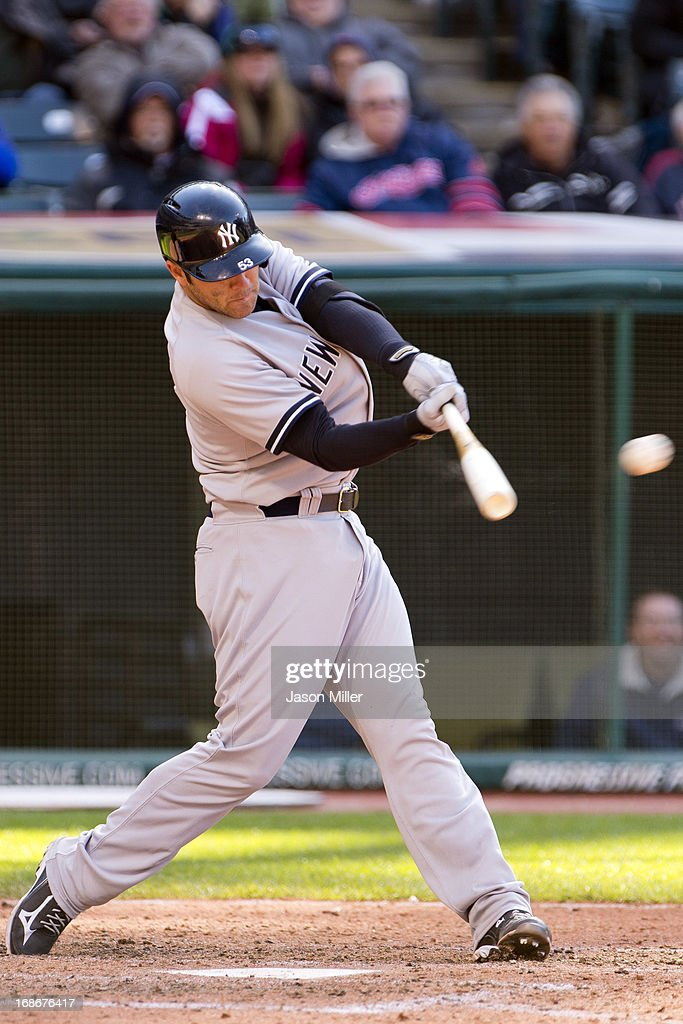 Austin Romine #53 of the New York Yankees hits an RBI single during the sixth inning against the Cleveland Indians during the second game of a doubleheader at Progressive Field on May 13, 2013 in Cleveland, Ohio.