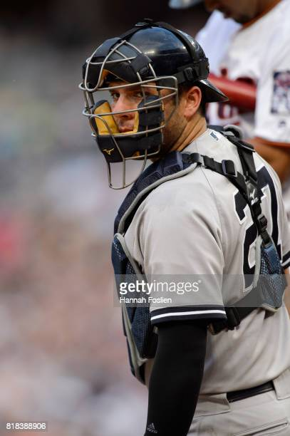 Austin Romine of the New York Yankees looks on while catching the game against the Minnesota Twins on July 17 2017 at Target Field in Minneapolis...
