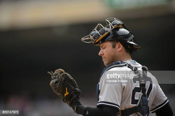 Austin Romine of the New York Yankees looks on while catching the game against the Minnesota Twins on July 19 2017 at Target Field in Minneapolis...