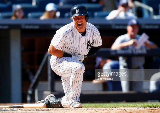 Austin Romine of the New York Yankees reacts after being hit with a pitch during the sixth inning against the Tampa Bay Rays at Yankee Stadium on...