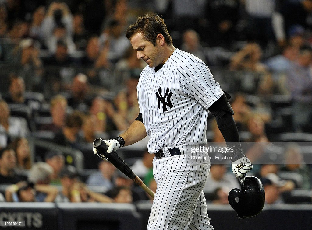 Austin Romine #71 of the New York Yankees reacts after striking out with the bases loaded to end the bottom of the ninth inning against the Boston Red Sox on September 25, 2011 at Yankee Stadium in the Bronx borough of New York City.