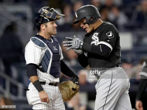 Austin Romine of the New York Yankees reacts as Avisail Garcia of the Chicago White Sox celebrates his three run home run in the seventh inning on...