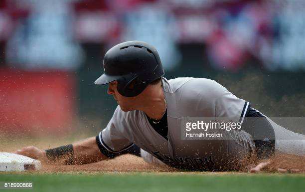 Austin Romine of the New York Yankees slides in safely to third base against the Minnesota Twins during the seventh inning of the game on July 19...