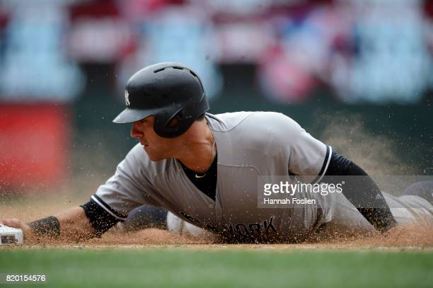 Austin Romine of the New York Yankees slides safely into third base against the Minnesota Twins during the game on July 19 2017 at Target Field in...