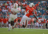 Austin Rose of the Nebraska Cornhuskers misses a pass defended by Jamal Carter of the Miami Hurricanes during a game at Sun Life Stadium on September...