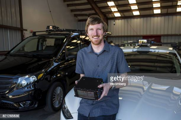 Austin Russell founder and chief executive officer of Luminar Technologies Inc holds a lidar box for a photograph after an interview at the company's...