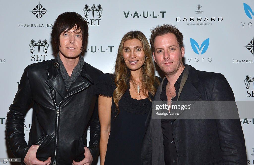 Austin Sands, Christina Sands and John Brevard attend the V.A.U.L.T. Art Basel Party on December 6, 2012 in Miami, Florida.