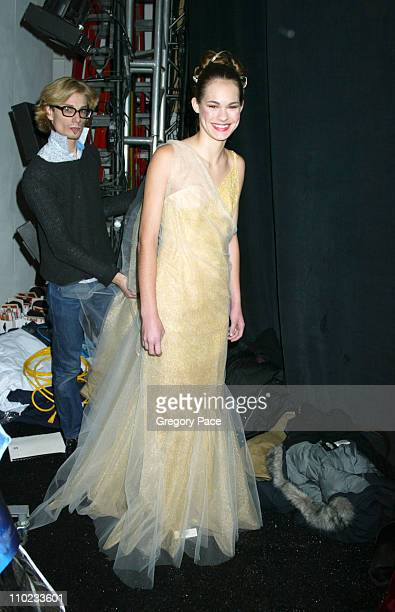 Austin Scarlett designer and finalist in the 'Project Runway' reality show on Bravo with a model backstage wearing one of his designs