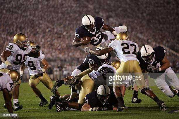 Austin Scott of the Penn State Nittany Lions leaps over the defense against the University of Notre Dame Fighting Irish at Beaver Stadium on...