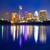 Austin skyline cityscape at night reflected in Ladybird Lake