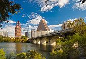 Austin skyline; Congress Avenue Bridge; Town Lake; tree-framed cityscape