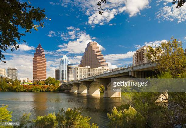 Austin skyline; Congress Avenue Bridge; Town Lake; tree-framed cityscape