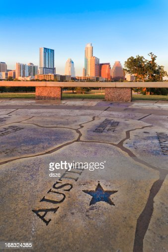 Austin skyline with Texas map in foreground.