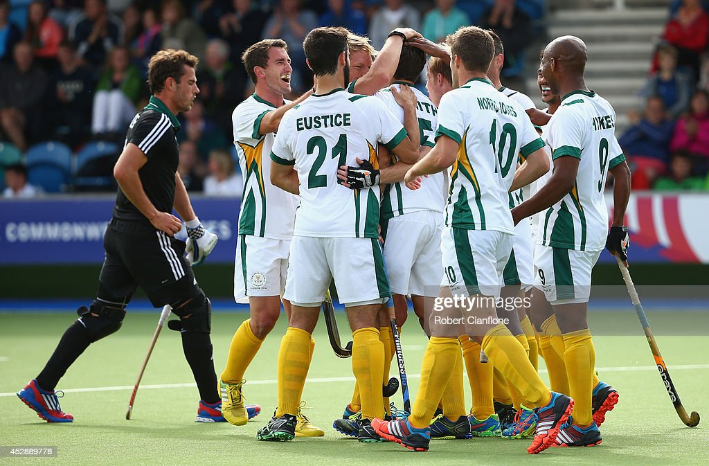 Austin Smith of South Africa celebrates with team mates after he scored a goal during the men's preliminaries match between Wales and South Africa at the Glasgow National Hockey Centre during day six of the Glasgow 2014 Commonwealth Games on July 29, 2014 in Glasgow, United Kingdom.