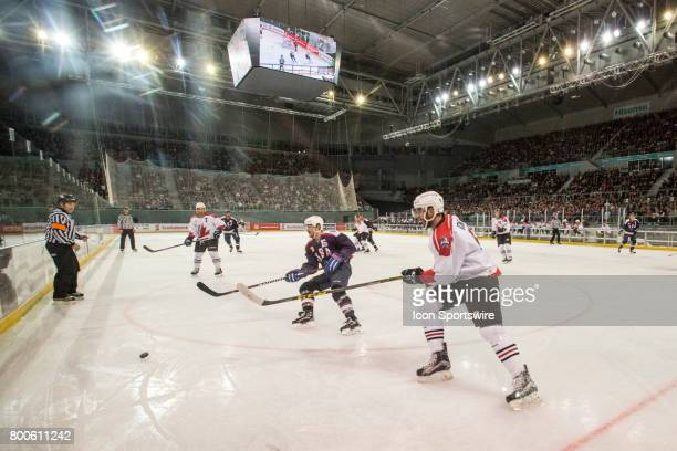 Austin Smith of Team USA and Brett Ponich of Team Canada chase down the puck during the Melbourne Game of the Ice Hockey Classic on June 24 2017 held...